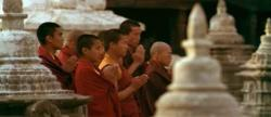 Tibetan buddhist monks prayer near Swayambunath stupa, Kathmandu, Nepal