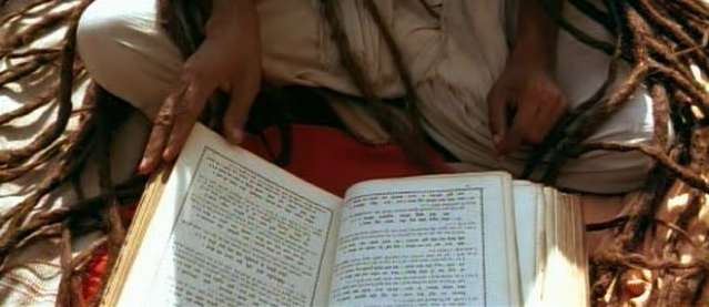 A  Hindu 'Sadhu'(Hermit) reading holy texts