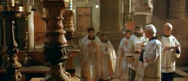 Priests praying inside the Church of the Holy Sepulchre in Jerusalem