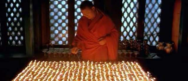 The above picture depicts a monk performing light offerings, which is a common and daily practice of monks or nuns in the Tibetan Buddhism tradition. There is no proof or evidence in which the above place was in fact in Jokang Lhasa. Also, the tibetan traditon practitioner do not meditate with fire as all outer phenomenon are all but an illusion as taught by the Lord Buddha, thus, practioner there will never rely on it.  It could be in Tibet, Bhutan, Nepal, India or other parts of the world.  Conclusion: Light Offerings To the Triple Gems (Buddha, Dharma, Sangha)