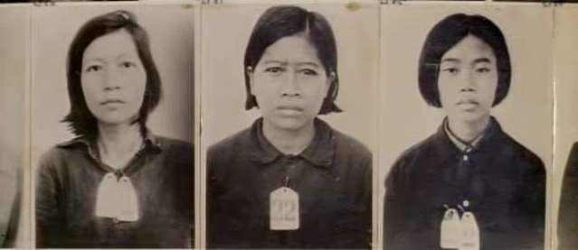 Photographs displayed at S21 torture chamber, Cambodia