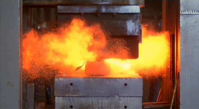 Hydraulic press forging metal