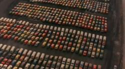 Docks where import cars where first unloaded in the 1970s?  It looks like VW Buses and, maybe, some Renault LeCars.
