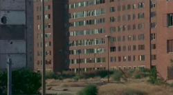 It is a photo of an abandoned Pruitt-Igoe  housing project ready to be demolished.