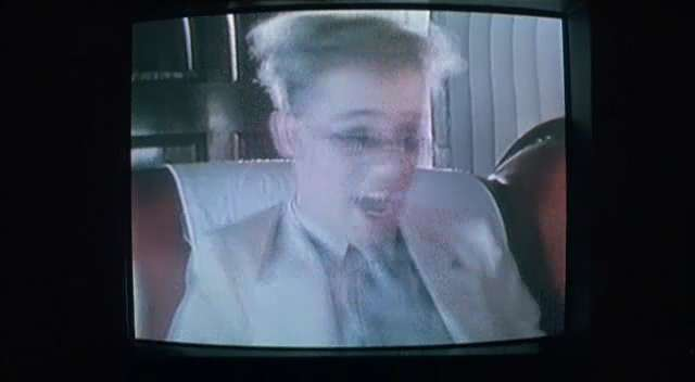 "Thomas Dolby music video clip ""She blinded me with science""."