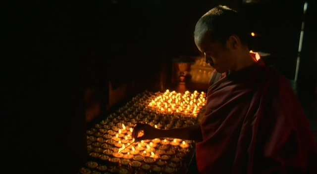Butterlamp offerings.  108 butterlamps made of yak butter are lit as an offering to Tara or Medicine Buddha.  Prayer: OM TARE, TU TARE, TURE SOHA. Tibetan ritual.