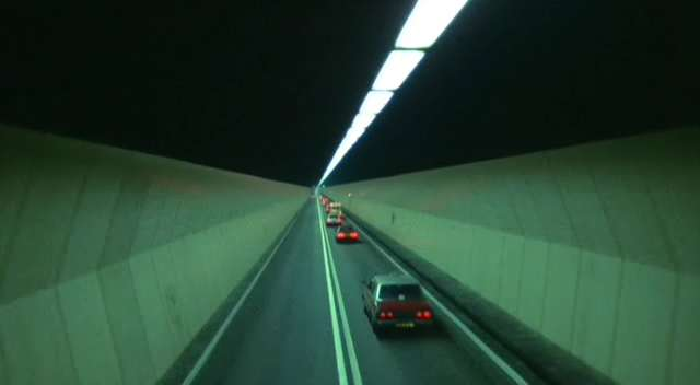 The image is easily recognizable as Hong Kong's distinctively-shaped Cross Harbour Tunnel, the first tunnel to connect Hong Kong Island to Kowloon.
