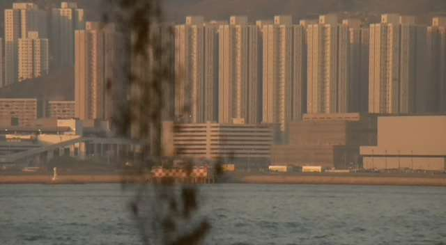 Raw sewage being dumped in a bay; Hong Kong in the background.