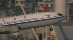 This is a shot of a Boeing 707 taking off from the now-demolished Kai Tak Airport in Kowloon Bay, Ho