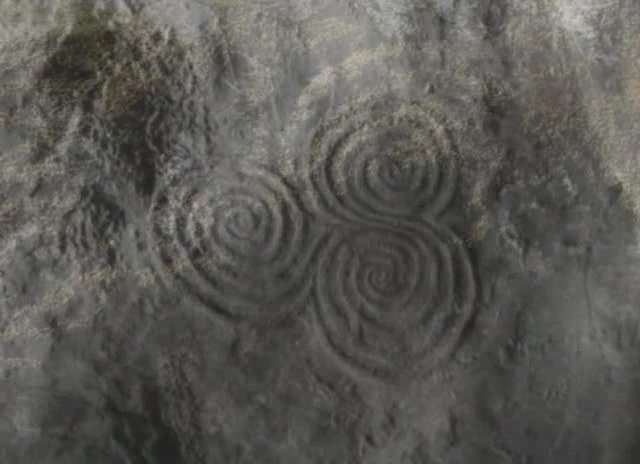 This Tri-spiral image is located in Newgrange passage tomb in County Meath, Ireland. The structure predates the pyramids and Stonehenge. Every year on the winter solstice the sun shines down the narrow passage and illuminates the chamber inside. This is where the trispiral is located.